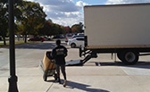 worker loading a truck for tulsa moving companies