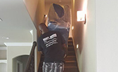workers on stairs doing residential moves for tulsa movers