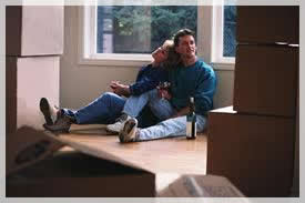 Packing Tips 2 people sitting on floor for movers tulsa